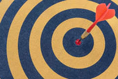 Dart target with arrow on bullseye Stock Photo