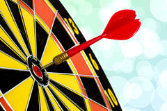 Dart target board with abstract bokeh background Royalty Free Stock Images