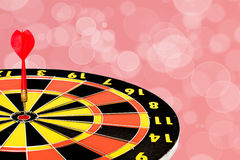 Dart target board with abstract bokeh background Royalty Free Stock Photography