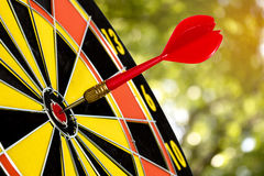 Dart target board, abstract of success with abstract nature bokeh blur background Royalty Free Stock Photography