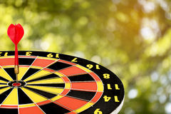 Dart target board, abstract of success with abstract nature bokeh blur background Stock Photo