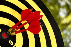 Dart target board, abstract of success. With abstract nature bokeh blur background Stock Images