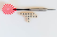 Dart Target Focus Goal. The words target, focus and goal written in cube letters and a dart on white backgound royalty free stock photos