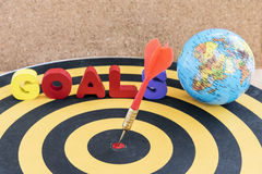 Dart Target In Bullseye On Dartboard With Goals And Globe Stock Images