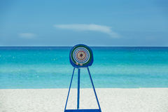 Dart target metal stand on tropical beach and ocea Stock Image