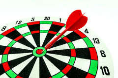 Dart target with red arrows Stock Photos