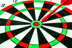 Dart target with red arrows Stock Images
