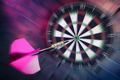 Dart about to hit target with dramatic lighting Royalty Free Stock Photos