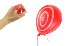 Dart about to pop a balloon Royalty Free Stock Images