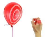 Dart about to pop a balloon Stock Photos