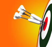 Dart View. Three white darts landed on the bull's eye area a 3D model Royalty Free Stock Photography