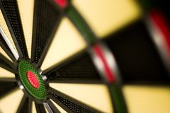 Dartboard. Closeup of dartboard with bullseye in lower corner and very shallow DOF Royalty Free Stock Photos