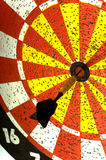 Dartboard. With single dart in the middle or bulls -eye.  symbol of hitting the target or making the goal Stock Image