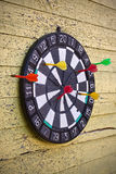 Dartboard. Not professional dartboard on the wooden wall royalty free stock photos