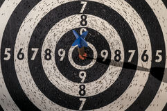 Dartboard with arrow in centre Royalty Free Stock Photos
