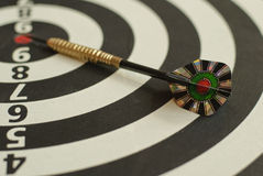 Dartboard and arrow Stock Images