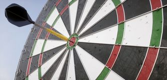 Dartboard with arrow in the middle - 3D Rendering Royalty Free Stock Photo