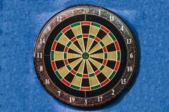 A dartboard on blue background Stock Images