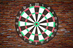 Dartboard on brick wall. In old house Stock Image