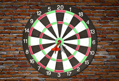 Dartboard on brick wall Royalty Free Stock Photography
