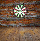 Dartboard on brick wall Royalty Free Stock Image
