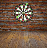 Dartboard on brick wall Royalty Free Stock Images