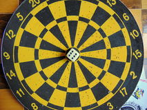 Dartboard with cards on chessboard. Dartboard with cards laying on chessboard Royalty Free Stock Photography