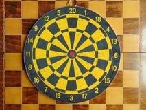 Dartboard with cards on chessboard. Dartboard with cards laying on chessboard stock photography