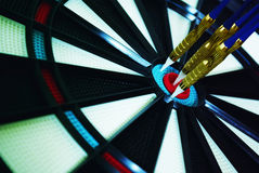 Dartboard center. Darts in the center of the dartboard Royalty Free Stock Images