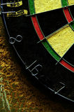Dartboard Close Up. Detail shot of a dartboard in a bar with the numbers 8, 16, and 7 Royalty Free Stock Image