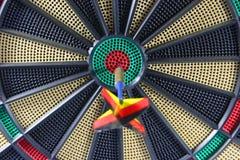 Dartboard con la freccia Fotografie Stock