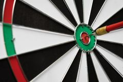 Dartboard. Dart arrow hitting in the target center of dartboard Royalty Free Stock Images
