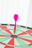 Dartboard with dart Stock Photos