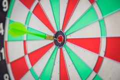 Dartboard with dart Stock Images