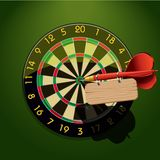 Dartboard with dart and blank table Royalty Free Stock Photography