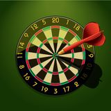 Dartboard with dart in the center Stock Photo