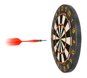 Dartboard with dart flying in aim royalty free stock photography