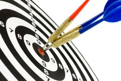 Dartboard and darts. Dartboard with three darts in a bulls eye Royalty Free Stock Photography
