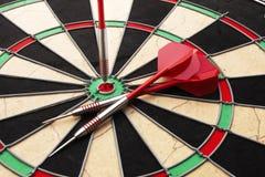 Dartboard and darts. Close up of a dartboard and darts with a bullseye Stock Image
