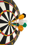 Dartboard with darts in aim Stock Photography