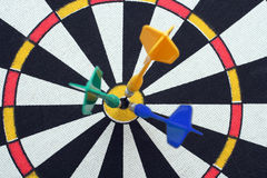 Dartboard with darts in aim Royalty Free Stock Photos
