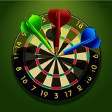 Dartboard with darts in the center Stock Photos