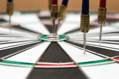 Dartboard. Darts hitting in the target of dartboard Royalty Free Stock Photos