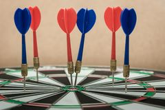 Dartboard. Darts hitting in the target center of dartboard Royalty Free Stock Photo