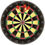 Dartboard with darts isolated Royalty Free Stock Photography