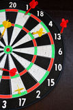 Dartboard with darts. Stock Photos