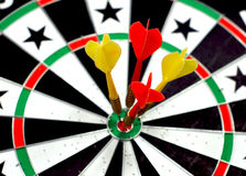 Dartboard with 4 darts Royalty Free Stock Images