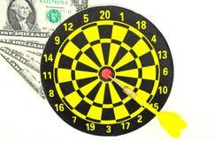 Dartboard e algum mone Imagens de Stock Royalty Free