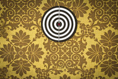 Dartboard on fabric wallpaper. Stock Image