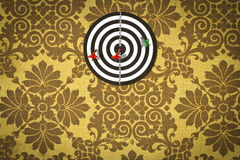 Dartboard on fabric wallpaper. Royalty Free Stock Images